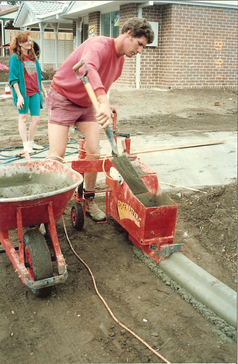 sheralyn supervises the curbing installation at a new home site in