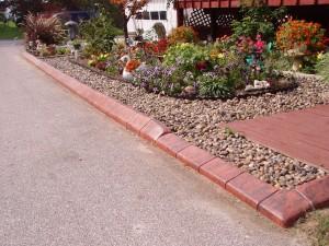 The Decorative Edge retains river stone.