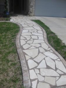 The Decorative Edge borders a flagstone path