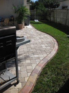 The Decorative Edge borders a paved barbeque area.