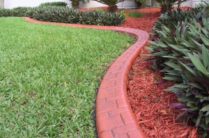 Terracotta curbing is a popular choice to blend with earthy colors.
